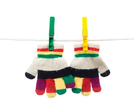 multi colour two kid gloves on clothes line isolated on white Stock Photo - 2112195