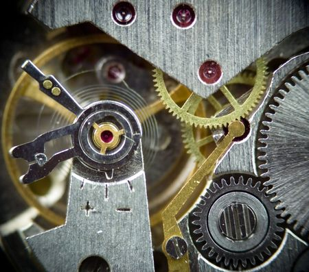 super macro part of clock mechanism, old watch with gems photo