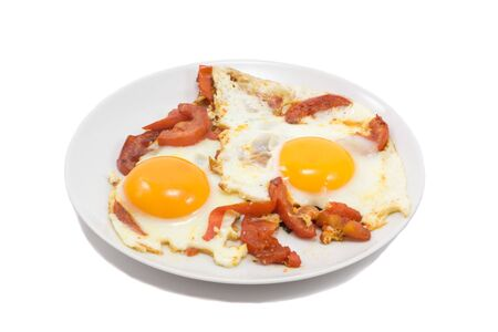 sunnyside: two fried eggs with tomatos on plate, isolated on white Stock Photo