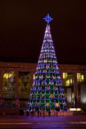 tonight: Big Cristmas tree on square, shooting tonight Stock Photo