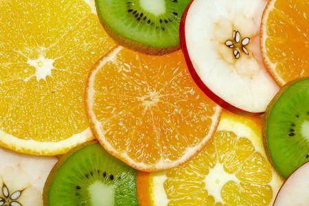 fruits background from slices kiwi, apple, tangerine and orange photo
