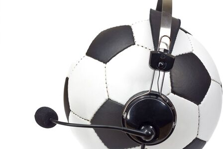 commentator: soccer concept, classic ball in headphones, as commentator isolated on white