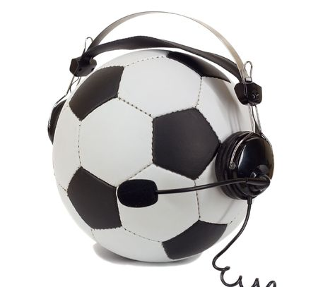 commentator: soccer concept, ball in headphones, as commentator isolated on white Stock Photo