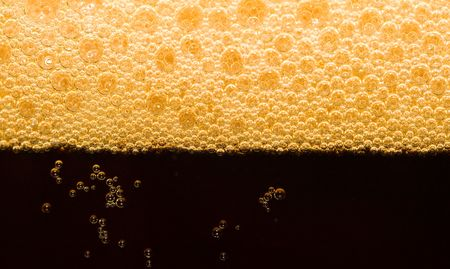 close-up dark beer with foam photo