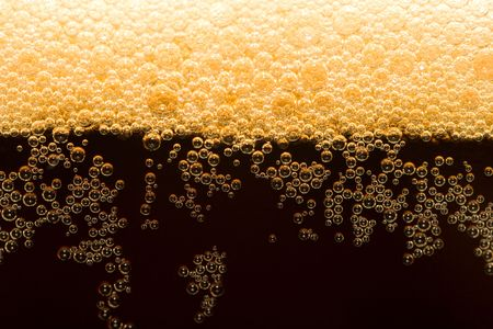 unstrained: appetizing filtered dark beer with foam Stock Photo