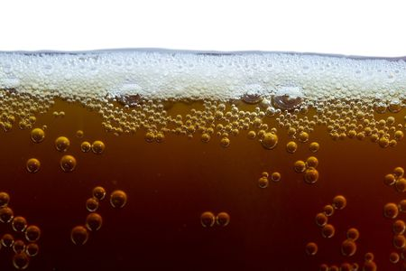 unstrained: close-up unfiltered dark beer with foam