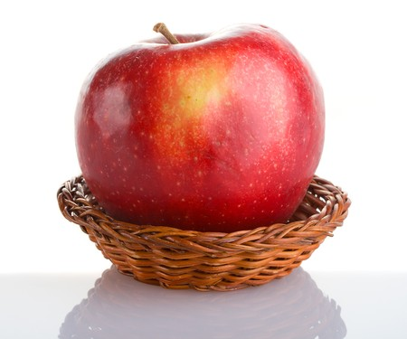 close-up red apple in basket with reflection, isolated on white Stock Photo - 3953500