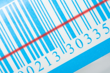 close-up blue barcode with red laser strip photo