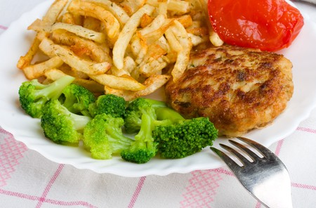close-up potatoes with cutlet and broccoli, on table-cloth photo