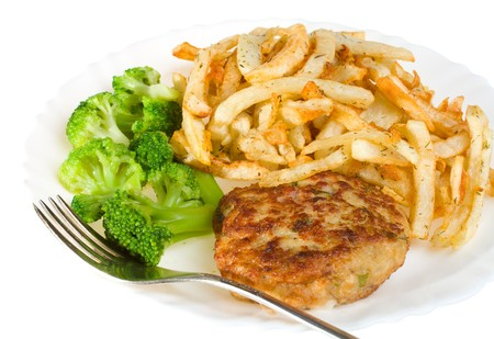 cutlet with broccoli and potatoes on plate, isolated photo
