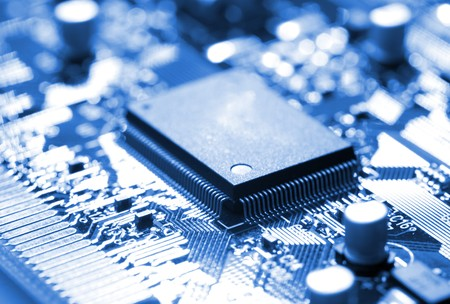 miniaturization: close-up microchip on circuit board, blue toning Stock Photo