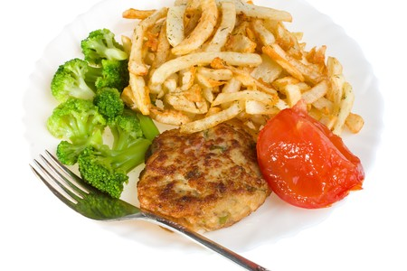 cutlet with tomato, broccoli and potatoes on plate, isolated photo