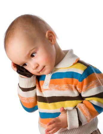 little boy talking on phone, isolated on white Standard-Bild