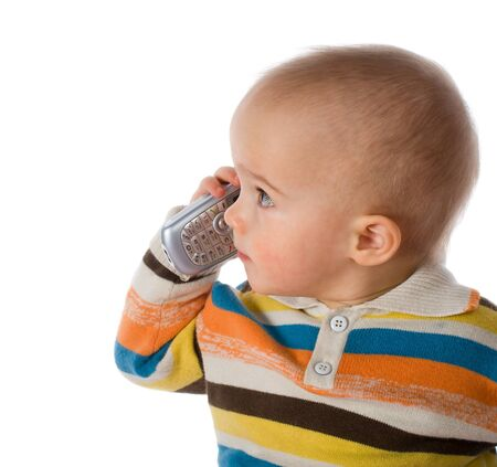 little boy talking on phone, isolated on white Stock Photo - 4521602