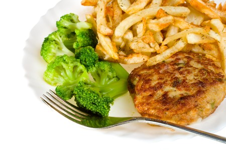 close-up cutlet with broccoli and potatoes on plate, isolated photo