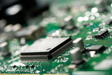 close-up microchip on green circuit board, selective focus Stock Photo - 4550177