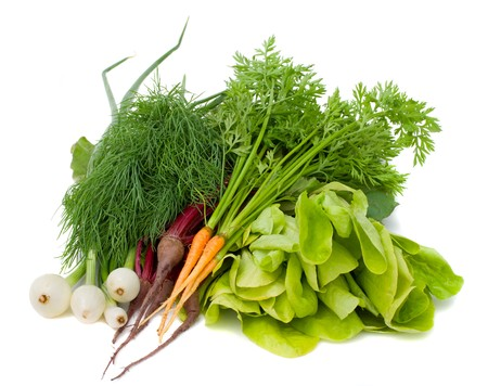 close-up heap of new vegetables, isolated on white photo