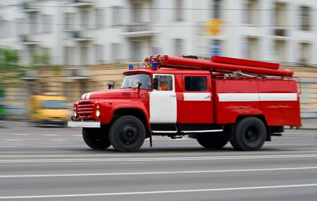 red fire-engine car in motion