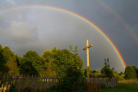 cross and rainbow after summer rain photo