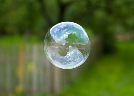 close-up soap bubble on green background photo