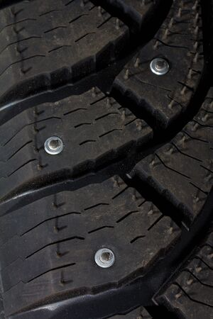 close-up new snow tire with studs photo