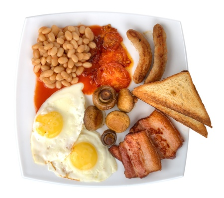 bacon baked beans: traditional english breakfast on plate isolated