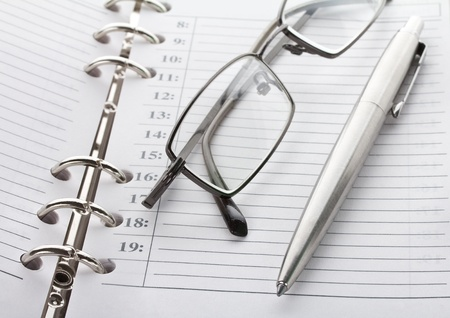 organizer: close-up notebook, pen and glasses