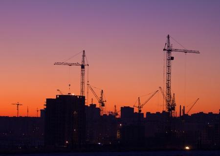 city under construction on sunrise photo