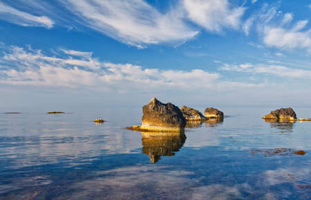 sea landscape with reflecting sky photo