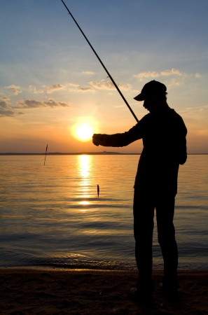 lonely fisherman fishing on sunset Stock Photo - 16171618