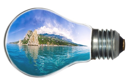 paradise island in light bulb, isolated on white photo