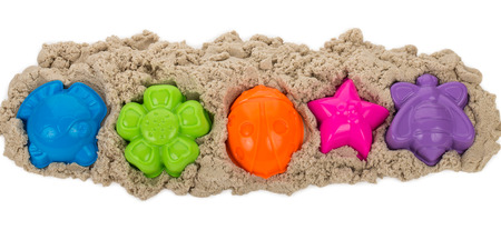 kinetic sand with multicolored molds, isolated on white