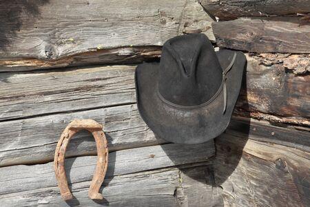 Worn cowboy hat and horseshoe