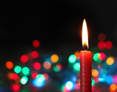 candle on dark bokeh background photo