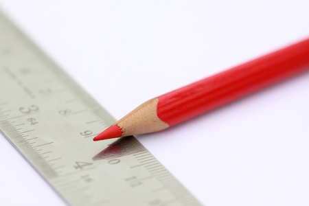 red colored pencil with stainless steel scale Stock Photo