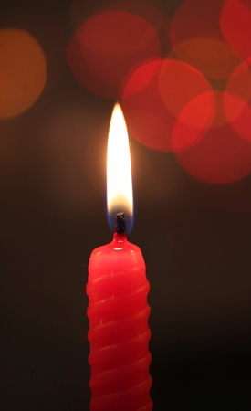 red candle on dark bokeh background Stock Photo