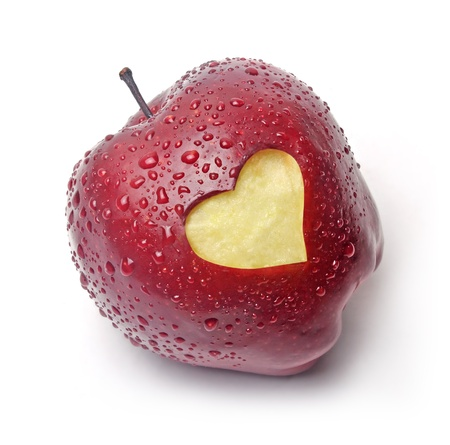 Fresh red apple with a heart symbol against white background photo