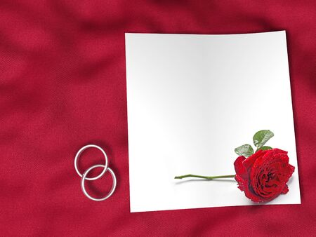 white paper, red rose and wedding rings on red silk textile Stock Photo