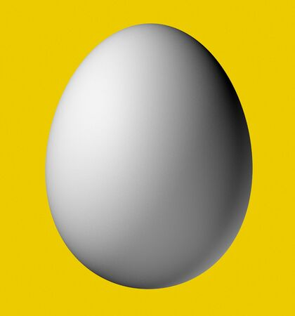 Egg isolated on a yellow background Stock Photo