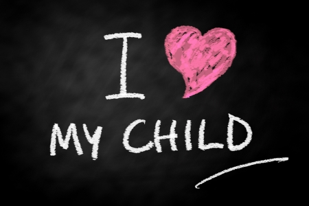 Digitally generated  I Love my child chalk text written on a blackboard Stock Photo