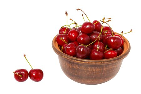 cherries in the bowl isolated on white