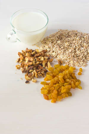 oatmeal raisins walnut milk  on a wooden table