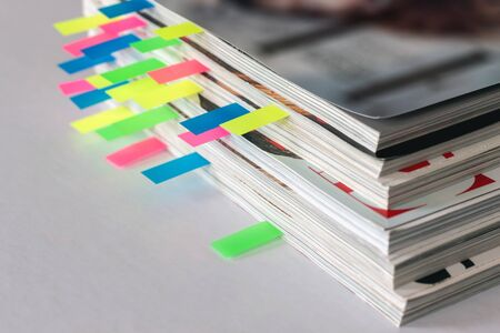 many colorful bookmarks in a magazine with the shallow depth of scene
