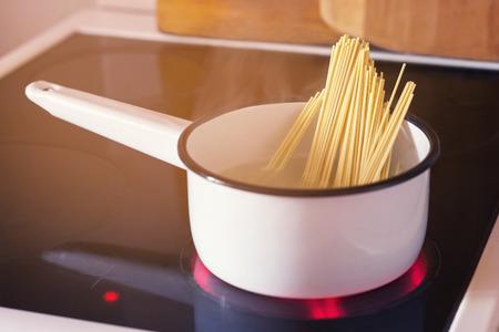 spaghetti boiling in pan on electric stove Reklamní fotografie