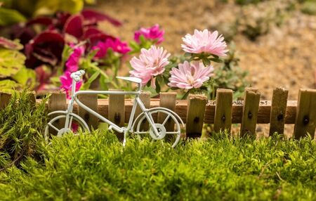 small bike miniature summer composition with flowers