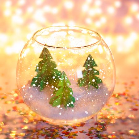 miniature with three paper pine trees in the aquarium. Stock Photo