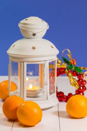 Christmas lantern with tangerines