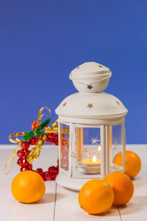 Christmas lantern with tangerines