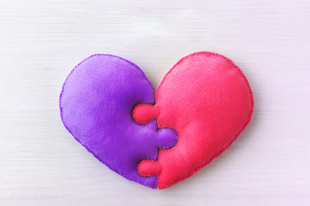 Heart shape made of two felt details, symbol of perfect soul mates