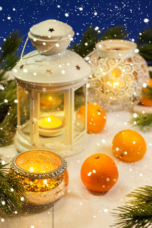 Christmas lanterns with tangerines and pine tree
